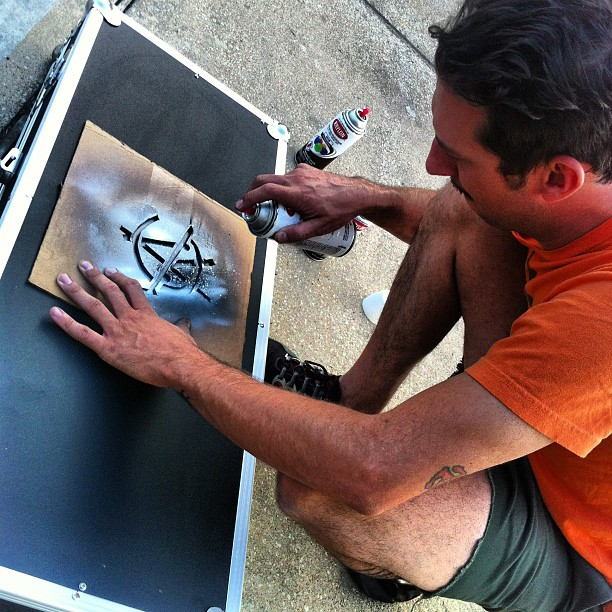 @gigantic stenciling for the #wolfandsnakestour. @riverboatgamblers @cobraskulls #gffg